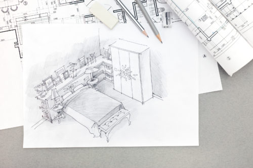 architectural sketch of bedroom with pencils, eraser, sharpener and blueprints