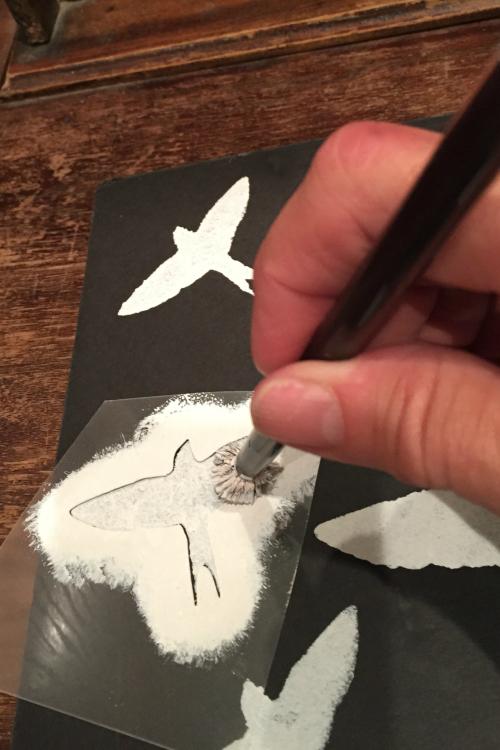 bird stencil with hand